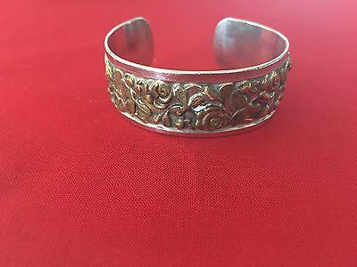 Serling silver 925 woman bracelet with brass flowers flowers on it