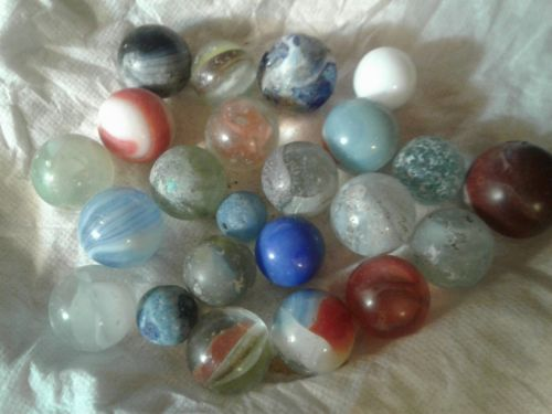 23 old marbles