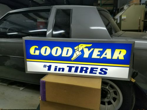 Lighted Goodyear tire sign