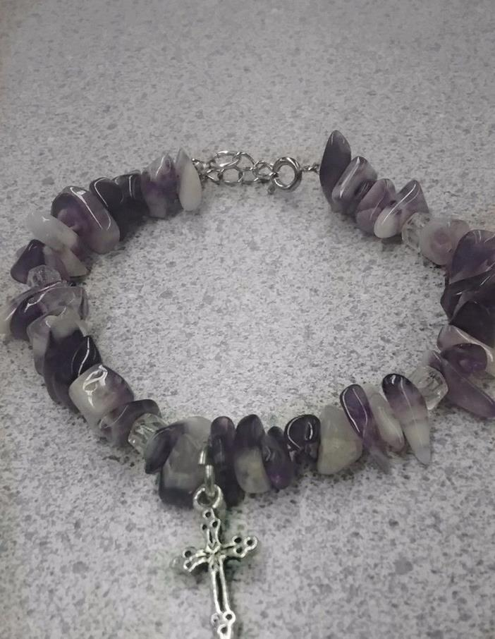 Homemade purple beaded bracelet with silver adjustable clasp and a silver cross