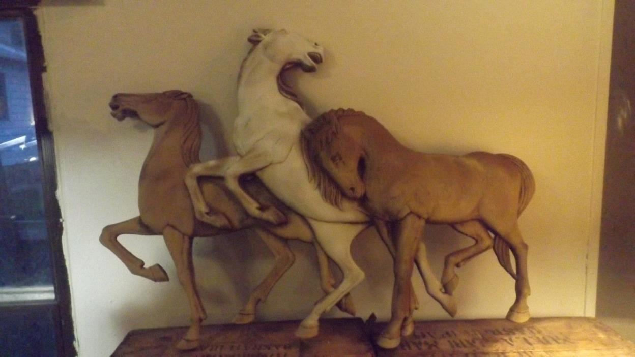 Large wall hanging of three horses