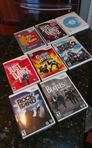 Lot Of 7 Wii Games plus bonus lens Cleaning kit all with cases & 6 booklets