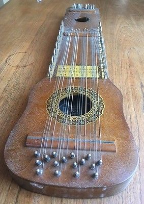Vintage Ukelin musical instrument with bow and tuning key, 1925