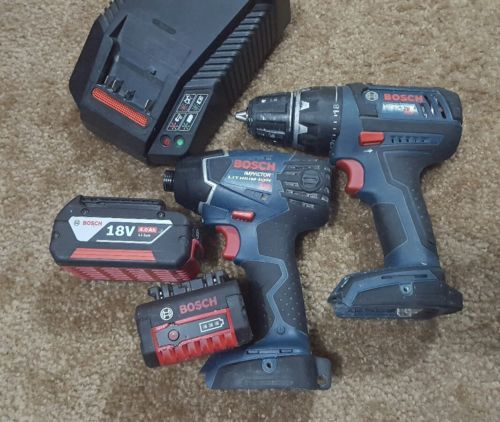 Bosch Drill and Impact 4.0 Ah 18 Volt Set with Charger Used  Good Working Combo