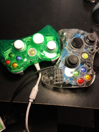 Two xbox 360 controllers Green And Clear Glow