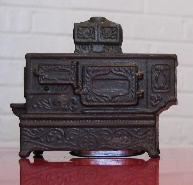 * Vintage Metal Banthrico figural bank wood burning stove