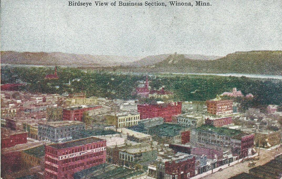 Winona, Minnsesota. Birdseye View of Business District Postcard.