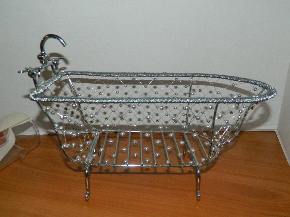 silver wire metal basket shaped like a bath tub w/ claw feet bathroom storage