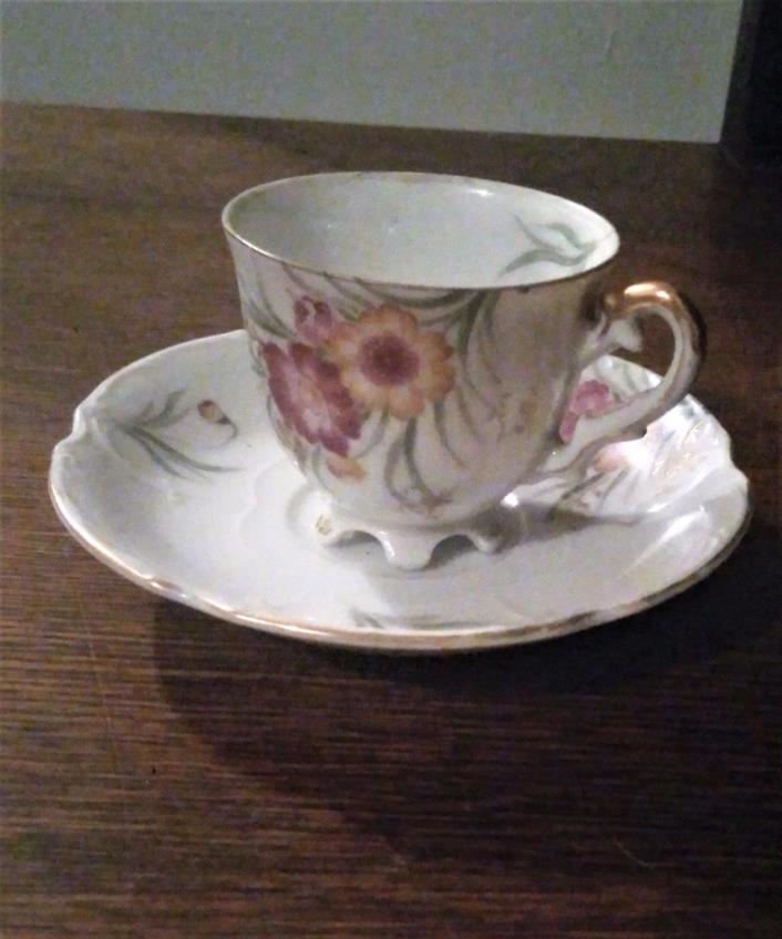 MADE IN OCCUPIED JAPAN MINIATURE TEACUP AND SAUCER.
