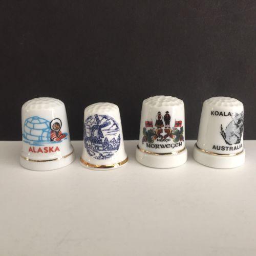 Lot of 4 Porcelain Thimbles ALASKA AUSTRALIA NORWAY HOLLAND
