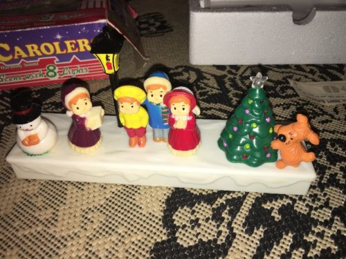 Yuletide Carolers Vintage Lights And Music Christmas Scene