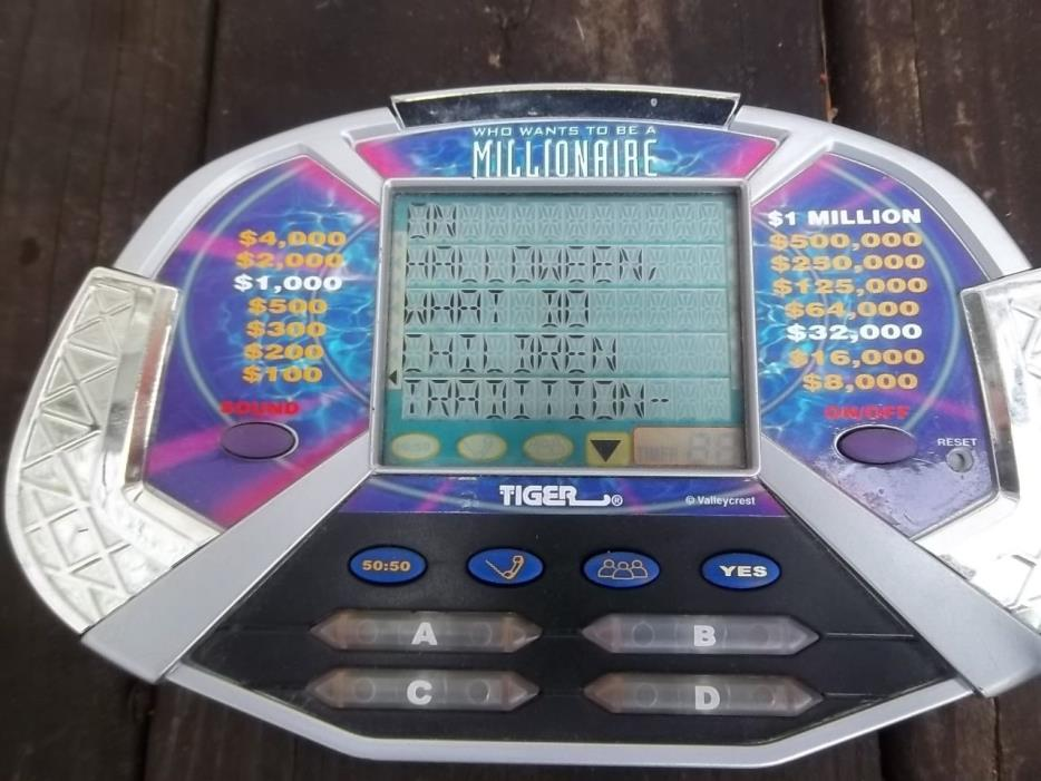 WHO WANTS TO BE A MILLIONAIRE Tiger Electronics Handheld Video Game 2000