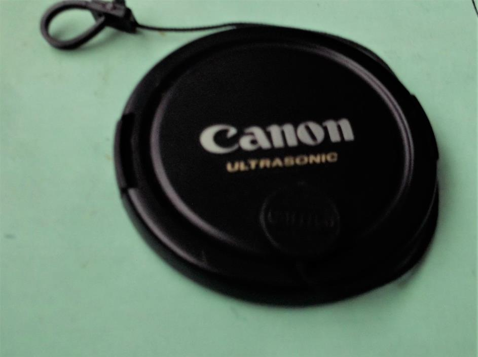 GENUINE CANON BRAND SNAP-ON FRONT LENS CAP E-67 USM ,CAP KEEPER ATTACHED.