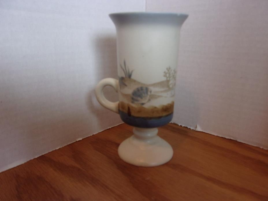 SEASHEELS. CUPS,, CANDLE HOLDERS,?? 5 1/2'' TALL.