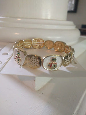 Gold toned bracelet with snowmen and snowflakes