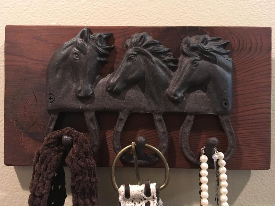 Cast iron horse head organizer hooks on barn wood