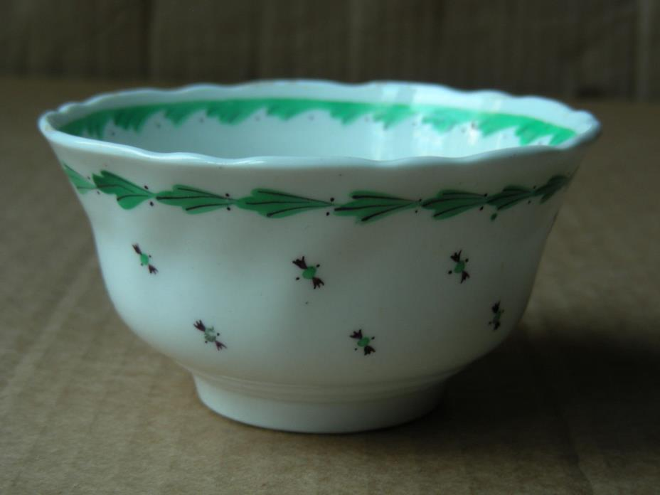 VINTAGE WHITE WITH GREEN & BLACK PORCELAIN TEA BOWL