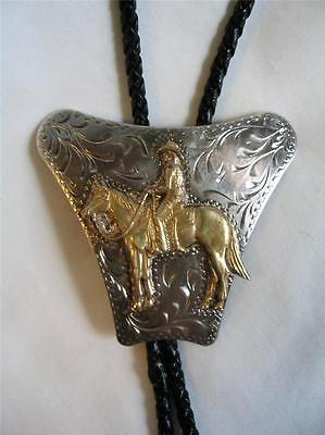 VINTAGE SOUTHWESTERN ETCHED SILVER W BRASS COWBOY ON HORSE ~ BOLO TIE MARKED AM