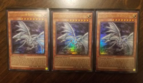 Blue-Eyes Alternative White Dragon (Playset x3 Near Mint)