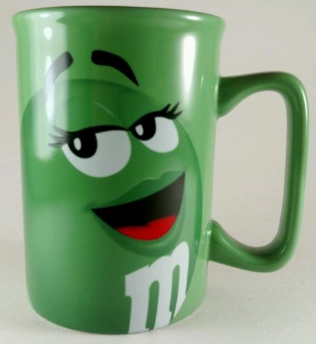 Green M&M Coffee Mug Mars Inc 2011 TM Smiling Face Long Eyelashes Tea Cup