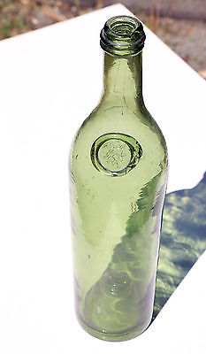 large, unusual (man with bottle in hand), applied seal antique bottle