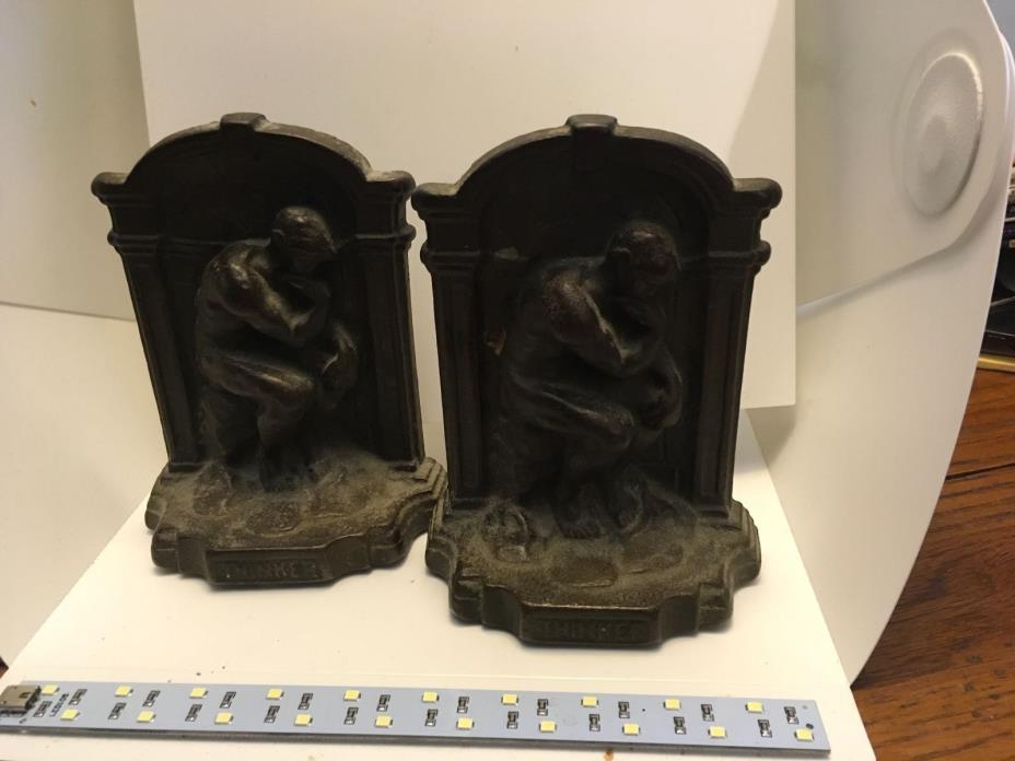 ANTIQUE PAIR OF CAST IRON BOOKENDS