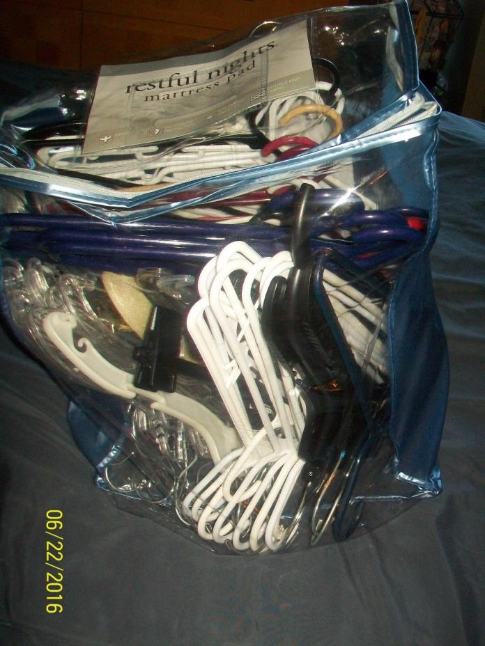 LOT 106 plastic hangers various style including big zip up plastic storage bag