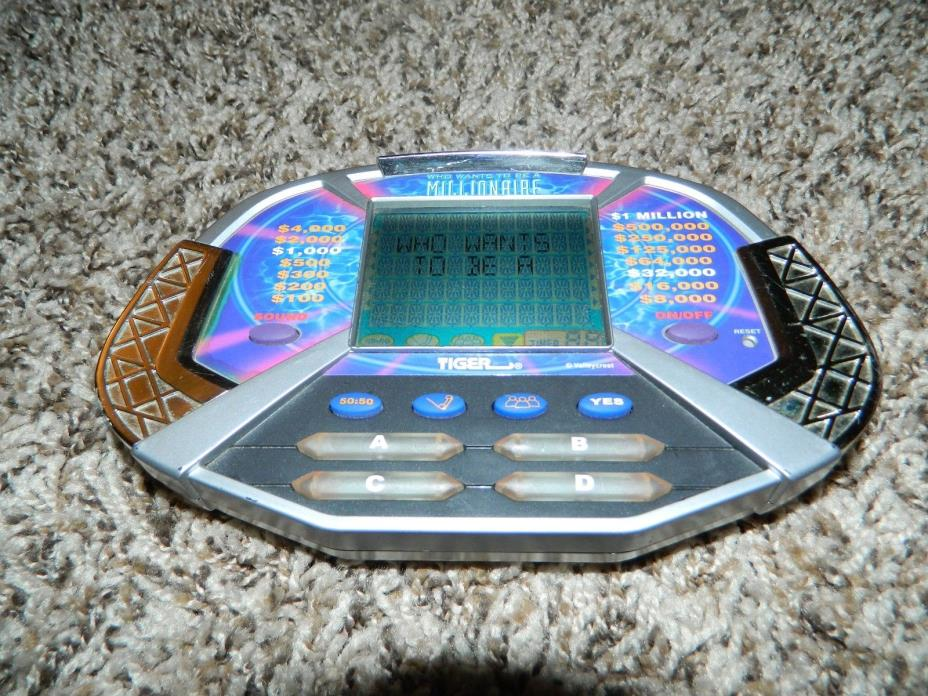 Who Wants to Be A Millionaire Handheld Electronic Travel Game ~ Works great