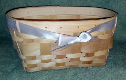 Decorative basket with white bow.....8 1/2