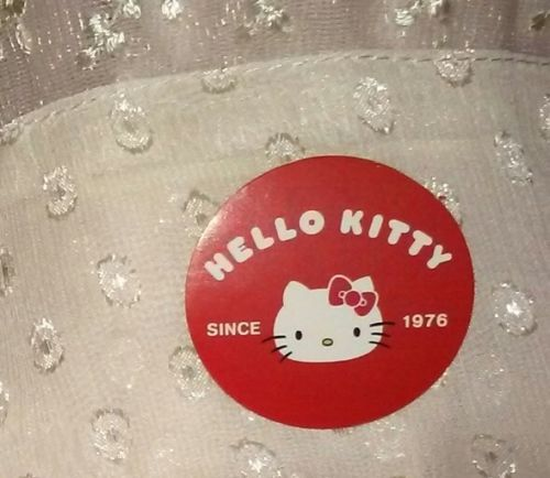 1-7/16in Hello Kitty sticker Since 1976 throwback vintage retro stylewhite red