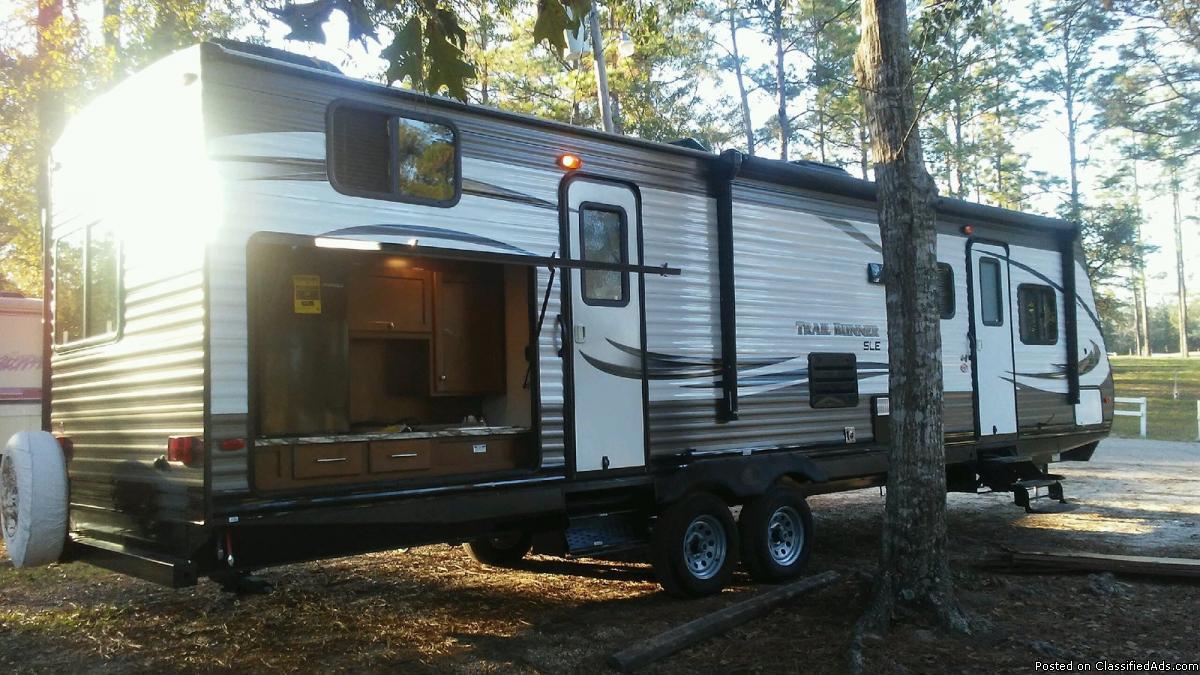 cheaper than 1/2 price, sleeps 9, 2 slides, camper new 2017 , 34 feet long