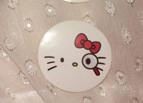 1-7/16in Hello Kitty sticker SPY private eye magnifying glass white red