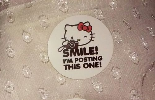 1-7/16in Hello Kitty Sticker 'SMILE! I'm posting this one!' camera photo