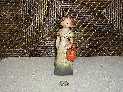Lady figurine green dress orange handbag design