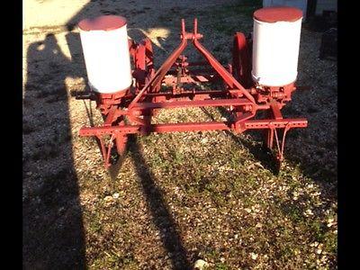 Two row Covington corn planter with corn plates