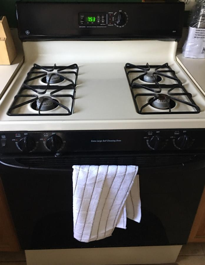 GE Fridge, four burner oven, and dishwasher set for sale.