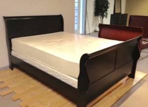 Queen black sleigh bed plus queen plush mattress