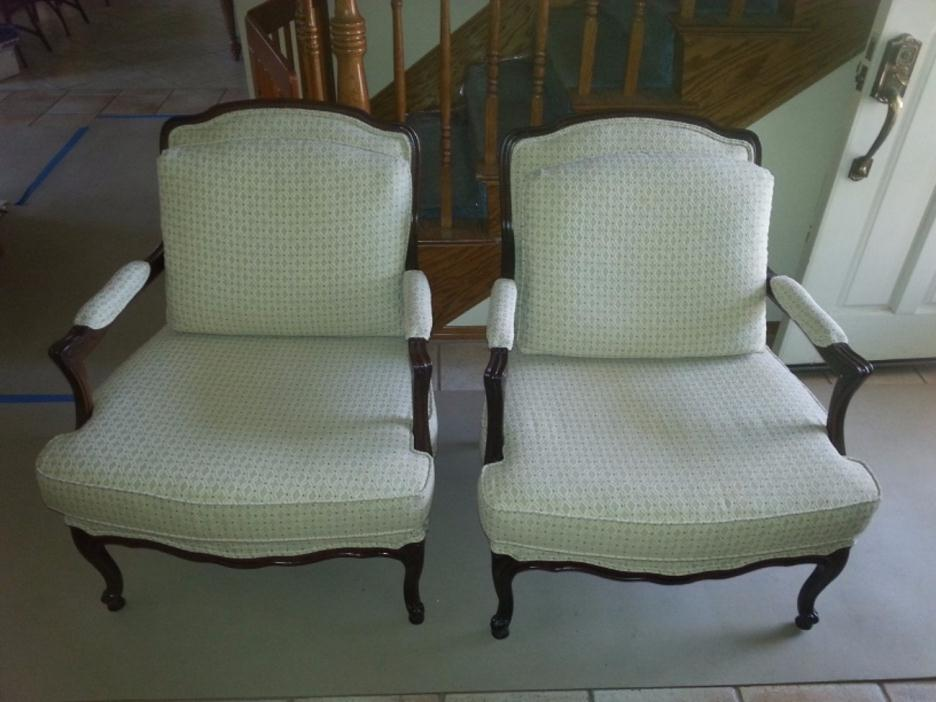 Matching upholstered wooden armchairs