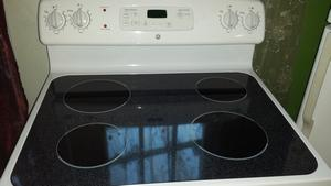 GE white electric glasstop stove range