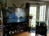 73in Mitsubishi flat screen TV with stand